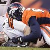 Photo - Cleveland Browns quarterback Brandon Weeden (3) is sacked by Denver Broncos defensive end Elvis Dumervil (92) in the third quarter of an NFL football game, Sunday, Dec. 23, 2012, in Denver. (AP Photo/Joe Mahoney)