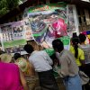 Visitors to the Ma Soe Yein monastery gather to look at posters displaying the