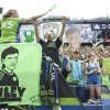 Photo - Seattle Sounders fans cheer for Seattle Sounders player Xander Bailey following a friendly soccer match against Tottenham Hotspur in Seattle, Saturday, July 19, 2014. The match ended in a 3-3 draw. Bailey was signed to the Sounders for the match as part of the Make-A-Wish program. (AP Photo/Stephen Brashear)