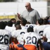 Photo - In this photo from Aug. 17, 2013, Texas El Paso head coach Sean Kugler, center, talks to his team following an NCAA college football practice in Alpine, Texas. (AP Photo/The El Paso Times, Mark Lambie) EL DIARIO OUT; JUAREZ MEXICO OUT;  EL DIARIO DE EL PASO OUT.