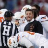 Photo -   Oklahoma State coach Mike Gundy talks to an official during a timeout in the third quarter of an NCAA college football game against Oklahoma in Norman, Okla., Saturday, Nov. 24, 2012. Oklahoma won in overtime, 51-48. (AP Photo/Sue Ogrocki)
