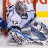 Los Angeles Kings goalie Jonathan Quick makes a save on a wraparound-attempt by Vancouver Canucks\' Alex Burrows during the first period of an NHL hockey game in Vancouver, British Columbia, Saturday, March 2, 2013. (AP Photo/The Canadian Press, Darryl Dyck)