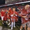Fans file out of the stadium during a storm delay before the start of the college football game between the University of Oklahoma Sooners (OU) and Texas Tech University Red Raiders (TTU) at the Gaylord Family-Oklahoma Memorial Stadium on Saturday, Oct. 22, 2011. in Norman, Okla. Photo by Chris Landsberger, The Oklahoman