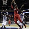 Atlanta Hawks\' Josh Smith (5) drives to the basket past Charlotte Bobcats\' Michael Kidd-Gilchrist (14) and Bismack Biyombo (0) during the first half of an NBA basketball game in Charlotte, N.C., Wednesday, Jan. 23, 2013. (AP Photo/Chuck Burton)