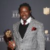 Photo - Eddie Lacy of the Green Bay Packers poses with his AP Offensive Rookie of the Year award at the third annual NFL Honors at Radio City Music Hall on Saturday, Feb. 1, 2014, in New York. (Photo by Mark Von Holden/Invision for NFL/AP Images)