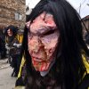 In this picture taken Sunday, Jan. 13, 2013, villagers wear masks of cannibals, made of natural materials, during the carnival in Macedonia\'s southwestern village of Vevcani. Said to date from pagan times 1,400 years ago, the Vevcani carnival, with its colorful floats and masked revelers, has grown in popularity over the last decade and attracts thousands of visitors for the celebrations on St. Vasilij Day to welcome in the New Year according to the Julian calendar. (AP Photo/Boris Grdanoski)