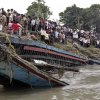 Photo -   Rescuers pull out the wreckage of a ferry that capsized in the Brahmaputra River at Buraburi village, about 350 kilometers (215 miles) west of the state capital Gauhati, India, Tuesday, May 1, 2012. Army divers and rescue workers pulled more than 100 bodies out of a river after a packed ferry capsized in heavy winds and rain in remote northeast India, an official said Tuesday. At least 100 people were still missing Tuesday after the ferry carrying about 350 people broke into two pieces late Monday, said Pritam Saikia, the district magistrate of Goalpara district. (AP Photo/Anupam Nath)