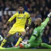 Photo - Chelsea's Diego Costa, left, is thwarted by Everton's goalkeeper Tim Howard during their English Premier League soccer match at Goodison Park Stadium, Liverpool, England, Saturday Aug. 30, 2014. (AP Photo/Jon Super)