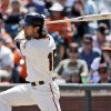 Photo - San Francisco Giants' Angel Pagan drives in two runs with a single against the Colorado Rockies during the fifth inning of a baseball game on Sunday, April 13, 2014, in San Francisco. (AP Photo/Marcio Jose Sanchez)