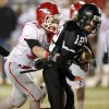 Josh Irvin (12) of Pond Creek-Hunter tries to break away from Fox\'s Jerry Mitchell (58) during a Class B semifinal high school football playoff game between Pond Creek-Hunter and Fox in Del City, Friday, Nov. 23, 2012. Photo by Nate Billings, The Oklahoman