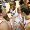 From left, OSU\'s Lindsey Keller (25), Toni Young (15) and Liz Donohoe (4) celebrate after the Women\'s NIT championship college basketball game between Oklahoma State University and James Madison at Gallagher-Iba Arena in Stillwater, Okla., Saturday, March 31, 2012. OSU won, 75-68. Photo by Nate Billings, The Oklahoman