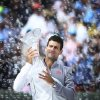 Novak Djokovic, of Serbia, holds his trophy after winning the Sony Open Tennis in Key Biscayne, Fla., Sunday, March 30, 2014, in Key Biscayne, Fla., defeating Rafeal Nadal, of Spain, 6-3, 6-3. (AP Photo/J Pat Carter)