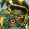 A Brazil soccer fan in costume cheers before the start of a live broadcast of a World Cup match between Brazil and Mexico inside the FIFA Fan Fest area on Copacabana beach, in Rio de Janeiro, Brazil, Tuesday, June 17, 2014. (AP Photo/Silvia Izquierdo)