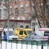 Photo - Ambulances are parked at an entrance to a school in Moscow, Russia, Monday, Feb. 3, 2014. Moscow police said an armed teenager burst into the school and killed a security guard and a teacher before being taken into custody. (AP Photo/Anton Belitsky)