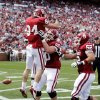 Don Caudill (84) is lifted by Austin Woods (50) in celebration after a touchdown pass reception during the annual Spring Football Game at Gaylord Family-Oklahoma Memorial Stadium in Norman, Okla., on Saturday, April 13, 2013. Photo by Steve Sisney, The Oklahoman