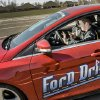 Collin Spangler tries to text and drive while navigating a course during Ford Driving Skills For Life at Yukon High School on Thursday. Photo by Chris Landsberger, The Oklahoman ORG XMIT: KOD CHRIS LANDSBERGER - CHRIS LANDSBERGER