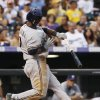 Photo - Milwaukee Brewers' Jean Segura reacts after fouling off an inside pitch against the Colorado Rockies in the fourth inning of a baseball game in Denver on Saturday, July 27, 2013. (AP Photo/David Zalubowski)