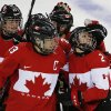 Photo - Meghan Agosta-Marciano of Canada (2) is congratulated by Caroline Ouellette (13) after scoring a goal against Finland during the third period of the 2014 Winter Olympics women's ice hockey game at Shayba Arena, Monday, Feb. 10, 2014, in Sochi, Russia. (AP Photo/Petr David Josek)