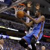 Oklahoma City\'s Kevin Durant (35) goes around Dallas\' Shawn Marion (0) during Game 4 of the first round in the NBA playoffs between the Oklahoma City Thunder and the Dallas Mavericks at American Airlines Center in Dallas, Saturday, May 5, 2012. Photo by Bryan Terry, The Oklahoman