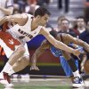 Toronto's Jose Calderon, left, tries to take the ball from Thunder guard Russell Westbrook during Oklahoma City's 112-96 loss Friday at the Air Canada Centre. Ap photo