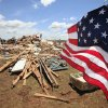 Tornado aftermath cleanup east of Piedmont, Wednesday, May 25, 2011. An American flag hangs from a small tree in the yard of Chad Brown and Becky Brown\'s house the was hit by Tuesdays tornado. Photo by David McDaniel, The Oklahoman