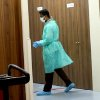 A hospital employee walks at Mount Elizabeth Hospital on Saturday Dec. 29, 2012 in Singapore. A young Indian woman who was gang-raped and severely beaten on a bus in New Delhi died Saturday at the hospital, after her horrific ordeal galvanized Indians to demand greater protection from sexual violence that impacts thousands of women daily, in homes, streets and public transport, but which often goes unreported. (AP Photo/Wong Maye-E)