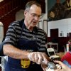 Photo -  University of Oklahoma head basketball coach Lon Kruger serves ice cream to OU employees at a social in their honor Thursday as part of OU Staff Week. PHOTO BY STEVE SISNEY, THE OKLAHOMAN  <strong>STEVE SISNEY -   </strong>