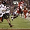 OU\'s Ryan Broyles dives for a touchdown past Darcel McBath, left, and L.A. Reed during the college football game between the University of Oklahoma Sooners and Texas Tech University at Gaylord Family -- Oklahoma Memorial Stadium in Norman, Okla., Saturday, Nov. 22, 2008. BY BRYAN TERRY, THE OKLAHOMAN