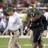 Photo - Baylor's Andrew Billings, right, leaves the field holding his right shoulder as coach Art Briles, left, walks off with him during the first half of the Fiesta Bowl NCAA college football game against Central Florida on Wednesday, Jan. 1, 2014, in Glendale, Ariz. (AP Photo/Ross D. Franklin)