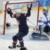 Photo - Hilary Knight of the Untied States celebrates her goal as Goalkeeper Noora Raty of Finland looks on during the women's ice hockey game at the Shayba Arena during the 2014 Winter Olympics, Saturday, Feb. 8, 2014, in Sochi, Russia. (AP Photo/Petr David Josek)