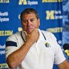 Photo - Michigan head coach Brady Hoke reacts as he answers questions at a news conference at the NCAA college football team's preseason media day, Sunday, Aug. 10, 2014, in Ann Arbor, Mich. (AP Photo/Tony Ding)
