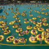 People cool off as they bathe at the aqua-park swimming pool in Minsk, Belarus, on Sunday, Aug. 9, 2015. Temperatures in the capital have reached around 32 degrees Celsius (89,6 F), drawing large crowds to the water park over the weekend. (AP Photo/Yauhen Leonov)