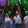 Photo - MURDERS, SHOOTING DEATHS, GIRLS, WELEETKA, TAYLOR PASCHAL-PLACKER, TAYLOR DAWN PASCHAL-PLACKER, SKYLA JADE WHITAKER, TAYLOR PLACKER, SKYLA WHITAKER: Rose Whitaker, center, stands next to her husband, William Whitaker as a group releases balloons following a prayer for justice to be served to those who killed Skyla Jade Whitaker, 11, and her friend, Taylor Paschal-Placker, 13, on a country road just north of Weleetka, Okla. June 8, 2010 marks the two-year anniversary of the killings. ADAM WISNESKI/Tulsa World ORG XMIT: DTI1006081442456504