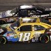 Kyle Busch (18) and Tony Stewart (14) battle side-by-side in Turn 4 during the NASCAR Sprint Cup Series auto race at Richmond International Raceway in Richmond, Va., Saturday, April 28, 2012. Busch won the race. (AP Photo/Zach Gibson)