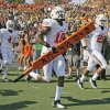 Oklahoma State\'s Brodrick Brown (19) carries the
