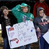 A student from Soldier Creek Elementary School salutes a patriotic float as it passes in front of school children on Douglas Blvd. The city of Midwest City teamed with civic leaders and local merchants to display their appreciation for veterans and active military forces by staging a hour-long Veteran\'s Day parade that stretched more than a mile and a half along three of the city\'s busiest streets Monday morning, Nov. 12, 2012. Hundreds of people lined the parade route, many of them waving small American flags that had ben distributed by volunteers who marched near the front of the parade. A fly-over performed by F-16s from the138th Fighter Wing, Oklahoma Air National Guard unit in Tulsa thrilled spectators. Five veterans representing military personnel who served in five wars and military actions served as Grand Marshals for the parade. Leading the parade was the Naval Reserve seven-story American flag, carried by 100 volunteers from First National Bank of Midwest City, Advantage Bank and the Tinker Federal Credit Union. The flag is 50 feet by 76 feet, weighs 110 pounds and was sponsored by the MWC Chapter of Disabled American Veterans. Photo by Jim Beckel, The Oklahoman