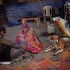 An Indian man and a woman keep themselves warm near a small bonfire next to stray dogs on a footpath on a cold morning in New Delhi, India, Wednesday, Jan. 9, 2013. North India continues to face below average weather conditions with dense fog affecting flights and trains. More than 100 people have died of exposure as northern India deals with historically cold temperatures. (AP Photo/Altaf Qadri)