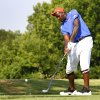 Photo - Kendrick Perkins tees off at his celebrity golf tournament at Oak Tree National, Wednesday, July 3, 2013. Photo by David McDaniel, The Oklahoman