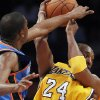 Photo - Oklahoma City Thunder forward Kevin Durant (35) defends against a pass by Los Angeles Lakers guard Kobe Bryant (24) during the first half of an NBA basketball game Monday, Jan. 17, 2011, in Los Angeles. (AP Photo/Alex Gallardo) ORG XMIT: LAS203