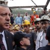 In this photo released by the Turkish Prime Minister\'s Press Office, Turkish Prime Minister Recep Tayyip Erdogan is surrounded by security members as he visits the coal mine in Soma, Turkey, Wednesday, May 14, 2014. Nearly 450 miners were rescued, the mining company said, but the fate of an unknown number of others remained unclear as bodies are still being brought to the surface and burials are underway after one of the world\'s deadliest mining disasters. (AP Photo/Kayhan Ozer, Turkish Prime Minister\'s Press Office, HO)