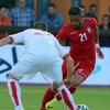 Photo - Iran's Ashkan Dejagah, right, challenges for a ball with Sasa Balic, left, of Montenegro during a friendly soccer match between Iran and Montenegro, in Hartberg, Austria, Monday, May 26, 2014. (AP Photo/Ronald Zak)
