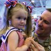 Eric Frazier holds his daughter Carley during the return ceremony for the National Guard\'s 45th Infantry Brigade Combat Team at the Army Aviation hanger at Will Rogers Air National Guard Base Sunday, March 25th, 2012. PHOTO BY HUGH SCOTT, FOR THE OKLAHOMAN