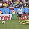 Photo - Nigeria's Joseph Yobo, right, scores an own goal during the World Cup round of 16 soccer match between France and Nigeria at the Estadio Nacional in Brasilia, Brazil, Monday, June 30, 2014.  (AP Photo/Martin Meissner)