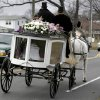 A horse drawn carriage carrying the body of Anna Grace Marquez-Greene leaves the church after her funeral in Bloomfield, Conn., Saturday, Dec. 22, 2012. Marquez-Greene, 6, was killed when gunman Adam Lanza opened fire at Sandy Hook Elementary School last week, killing 26 people, including 20 children, before killing himself. (AP Photo/Seth Wenig) ORG XMIT: CTSW112