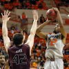 OSU\'s Markel Brown (22) shoots against Christian Kirk (42) of Missouri State during a men\'s college basketball between Oklahoma State University and Missouri State at Gallagher-Iba Arena in Stillwater, Okla., Saturday, Dec. 8, 2012. Photo by Nate Billings, The Oklahoman