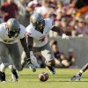 OKLAHOMA STATE UNIVERSITY: From right, Texas A&M\'s Kenric McNeal (5) watches as Oklahoma State\'s Justin Gilbert (4) recovers McNeal\'s fumble next to Markelle Martin (10) and Brodrick Brown (19) in the third quarter during a college football game between the Oklahoma State Cowboys and the Texas A&M Aggies at Kyle Field in College Station, Texas, Saturday, Sept. 24, 2011. OSU won, 30-29. Photo by Nate Billings, The Oklahoman ORG XMIT: KOD