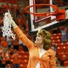 Shelley Budke, widow of OSU head coach Kurt Budke, points upwards after cutting down the last of the net after the OSU Cowgirls won the Women\'s NIT championship college basketball game between Oklahoma State University and James Madison at Gallagher-Iba Arena in Stillwater, Okla., Saturday, March 31, 2012. Kurt Budke and three others were killed in a plane crash on a recruiting trip in November of 2011. OSU won, 75-68. Photo by Nate Billings, The Oklahoman