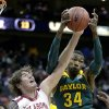 Photo - Oklahoma's Ryan Spangler (00) and Baylor's Cory Jefferson (34) battle for a rebound during the first half of an NCAA college basketball game in the Big 12 men's tournament on Thursday, March 13, 2014, in Kansas City, Mo. (AP Photo/Charlie Riedel)