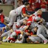 North Carolina State\'s Carlos Rodon (16) jumps on top of teammates as they celebrate their 5-4 win over Rice in the 17th inning of an NCAA college baseball tournament super regional game, Sunday, June 9, 2013, in Raleigh, N.C. (AP Photo/Karl B DeBlaker)