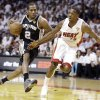 The San Antonio Spurs\' Kawhi Leonard (2) moves the ball against Miami Heat\'s Mario Chalmers (15) during the first half in Game 7 of the NBA basketball championships, Thursday, June 20, 2013, in Miami. (AP Photo/Lynne Sladky)